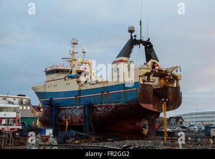 Boat in for service at Reykjavik Harbor - Stock Photo