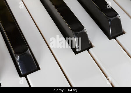 Extreme close-up of Piano keys from a diagonal perspective and shot with a shallow depth of field - Stockfoto