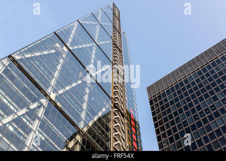 Facade of two glass modern skyscrapers with blue sky in the background. Shot from below. - Stock Photo