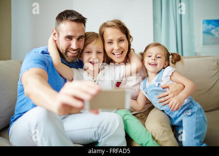 Selfie of happy family - Stockfoto