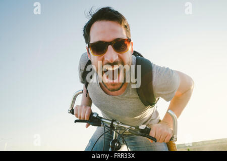 Man with bicycle having fun. retro style image. - Stock Photo