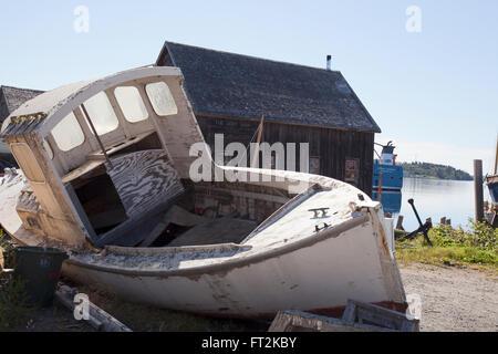 old abandoned boat behind dory shop   lunenburg nova scotia - Stock Photo