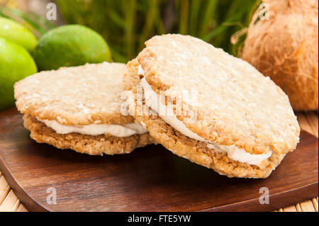 Vegan oatmeal cookie ice cream sandwich with coconut lime ice cream outdoors - Stock Photo