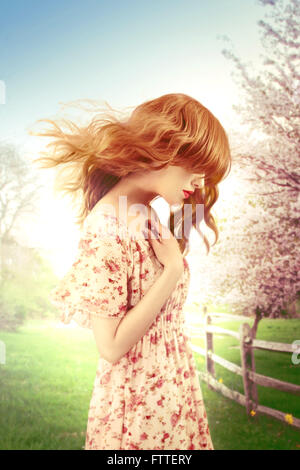 Woman on a windy spring day - Stockfoto