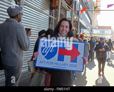 New York City, United States. 28th Apr, 2013. Hillary Clinton supporter with sign on 125th Street. Democratic primary - Stock Photo