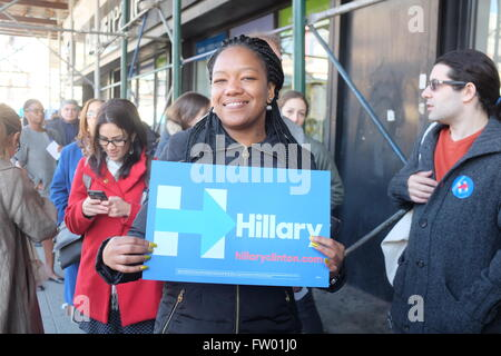 New York City, United States. 28th Apr, 2013. Clinton fan with sign on line outside Apollo Theater. Democratic primary - Stock Photo