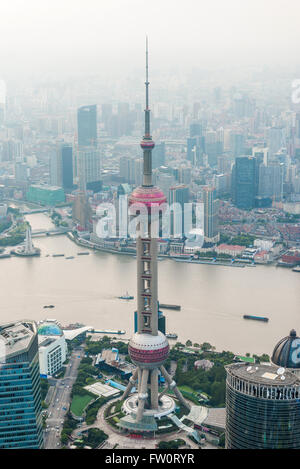 Shanghai aerial view at sunset with urban skyscrapers over river - Stock Photo