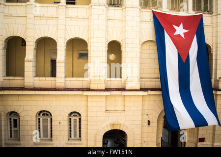 Cuban flag on old colonial building in Havana, Cuba - Stock Photo