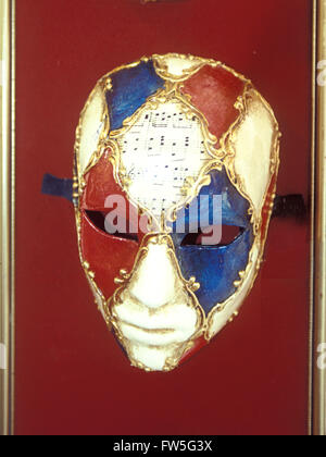 Carnival mask - with musical notation on display in Venice, Italy. - Stock Photo