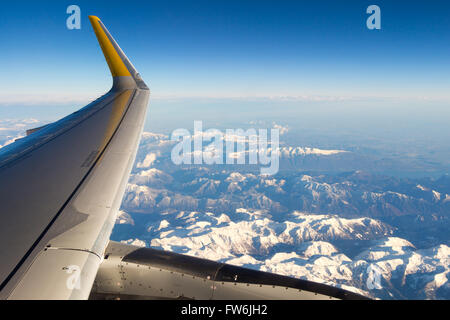 Clouds and sky as seen through window of an aircraft/airplane - Stock Photo