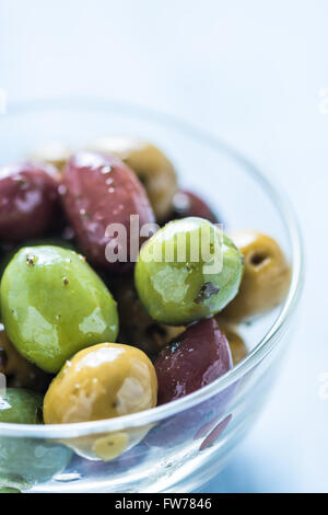 Fresh whole olives in bowl, with oil and spices.Spanish tapas concept. - Stock Photo