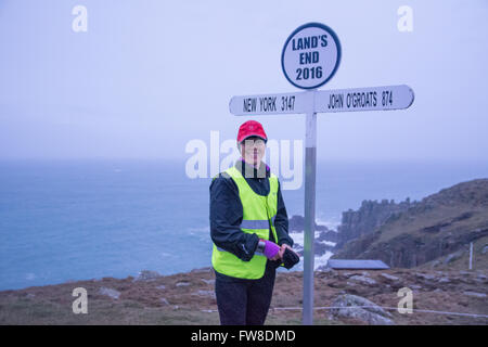 Lands End, Cornwall, UK. 2nd April 2016. Yvie Johnson setting off from a wet Lands End in her attempt to set the - Stock Photo