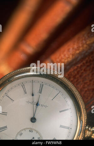 Antique Pocket Watch and Books - Stock Photo
