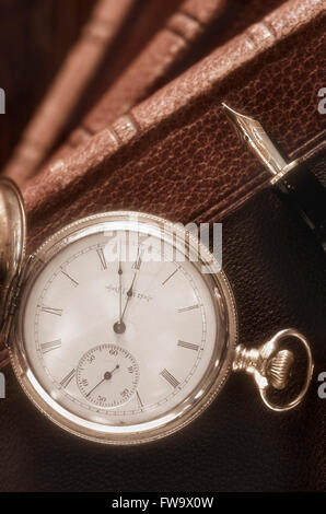 Antique Pocket Watch, Fountain Pen and Books - Stock Photo