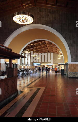 Interior of Union Station, Los Angeles, California, USA showing the information booth and commuters milling in the - Stock Photo