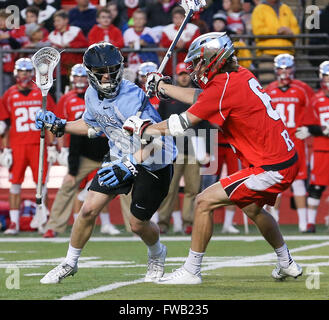Piscataway, NJ, USA. 2nd Apr, 2016. Johns Hopkins Patrick Foley (8) tries to get around Rutgers Connor Murphy (8) - Stock Photo