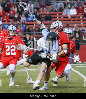 Piscataway, NJ, USA. 2nd Apr, 2016. Johns Hopkins Kieran Eissler (11) gets tripped up during an NCAA Lacrosse game - Stock Photo