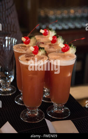 The famous cocktail drink,  'Singapore Sling' served in the Long Bar at the Raffles Hotel in Singapore. - Stock Photo