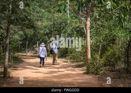 People walking to the Matrimandir, at Auroville, an experimental township in Viluppuram district in the state of - Stock Photo