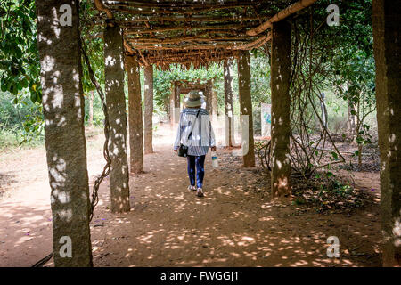 Lady walking to the Matrimandir, at Auroville, an experimental township in Viluppuram district in the state of Tamil - Stock Photo