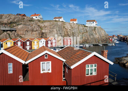 Traditional swedish red wooden houses in a snowy landscape stock photo royalty free image for Traditional scandinavian home design