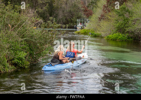 Two Girls Kayaking On The Weeki Wachee River Springs State Park Florida Taking Selfie Photos With A Smartphone And - Stock Photo