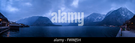 Panorama view of Hallstatt village in Alps at dusk, Austria - Stock Photo
