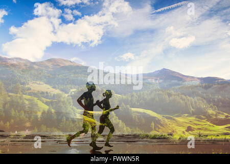 double exposure of two runners, eco trail in the nature, sport race competition, triathlon or marathon - Stock Photo