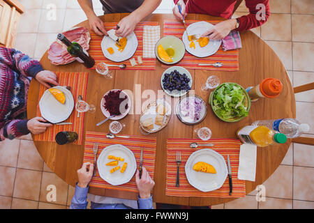 family at lunch eating starters, appetizers, top view of the table with food - Stock Photo