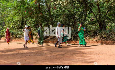 Indians walking to the Matrimandir at Auroville, an experimental township in Viluppuram district in the state of - Stock Photo