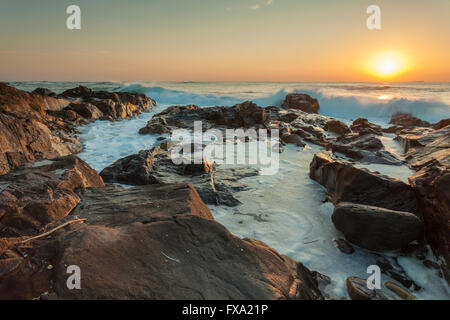Sunset on the beach in Porto, Portugal. - Stock Photo