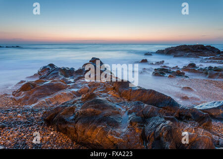 Evening on the beach in Porto, Portugal. - Stock Photo