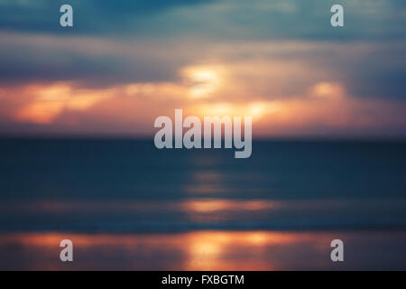 Blurred Image of Seascape with Sunset. Vintage Cross-processed Color. - Stockfoto