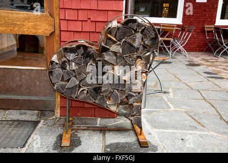 heart from chopped firewood in Bavaria - Stock Photo