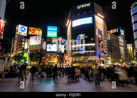 hachiko crossing in busy shibuya area of tokyo japan at night - Stock Photo