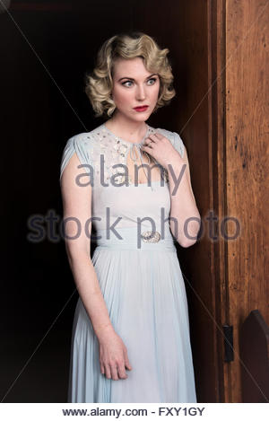 Glamorous 1940s woman in evening dress - Stock Photo