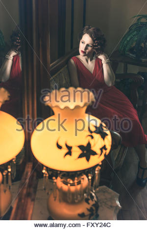 Woman in vintage 1940s dress - Stock Photo