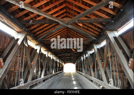 Old wooden bridge Red Covered Bridge over the Hoosic River, Buskirk, New York State, USA - Stock Photo