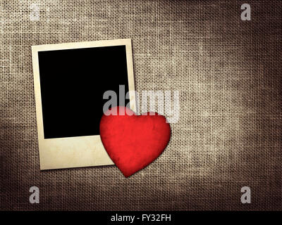 old style photo and red paper heart on a linen background - Stock Photo