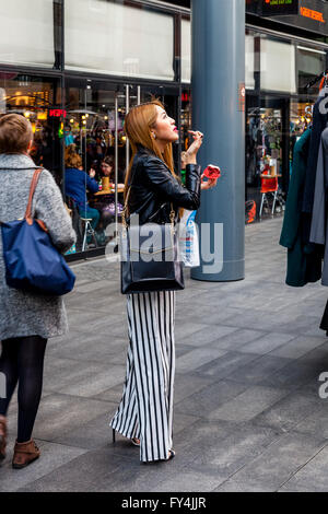 A Fashionable Young Woman In Old Spitalfields Sunday Market, London, England - Stock Photo