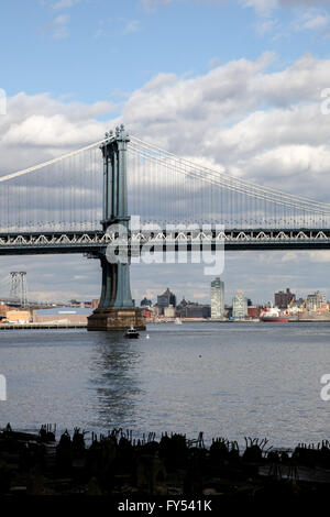 Manhattan bridge view from under Brooklyn Bridge, USA seen in New York. - Stock Photo