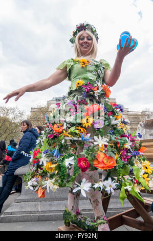 London, UK.  23 April 2016.  A woman dressed in spring flowers entertains visitors flocking to Trafalgar Square - Stock Photo