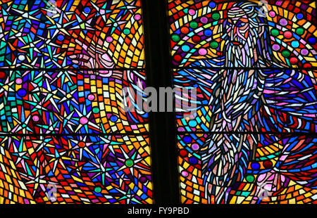 A stained glass window depicting one of the corporal acts for Designhotel elephant prague 1 czech republic