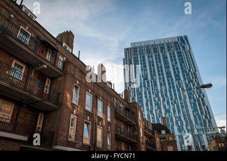 Deeply contrasting buildings in the East End of London where new skyscrapers go up next to the old. - Stock Photo