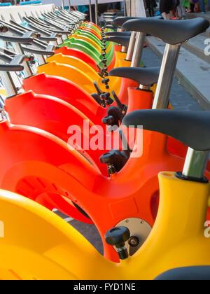 Colorful Aquatic bikes in Line, Designated for Swimming Pool - Stockfoto