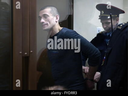 Moscow, Russia. 26th Apr, 2016. Artist Pyotr (Petr) Pavlensky (L) attends a hearing of St Petersburg's Magistrates - Stock Photo