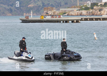 San Francisco Police Department Officers Afloat During The 2016 Polar Plunge, Alcatraz In The Background. - Stock Photo