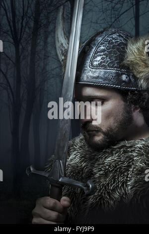 Peace, Viking warrior, male dressed in Barbarian style with sword, bearded - Stockfoto