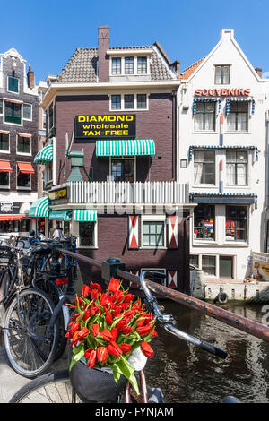 Amsterdam diamont factory , Grimnesssluis, bicycles, tulips,  Amsterdam, Netherlands - Stock Photo