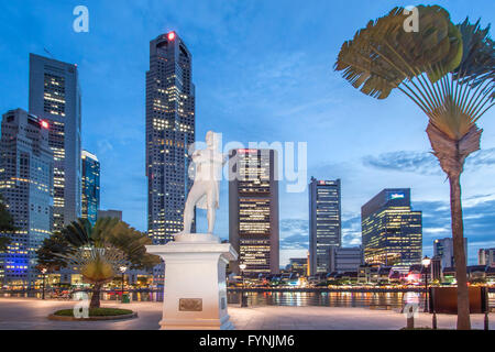 Skyline of Singapore , Raffles Statue,  South East Asia, twilight - Stock Photo